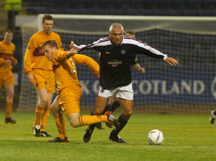Fabrizio Ravanelli (The White Feather) won the Champions League in 1996. Here, the striker escapes the attention of Motherwell players in 2003 during his short stint playing for Dundee FC (2003).